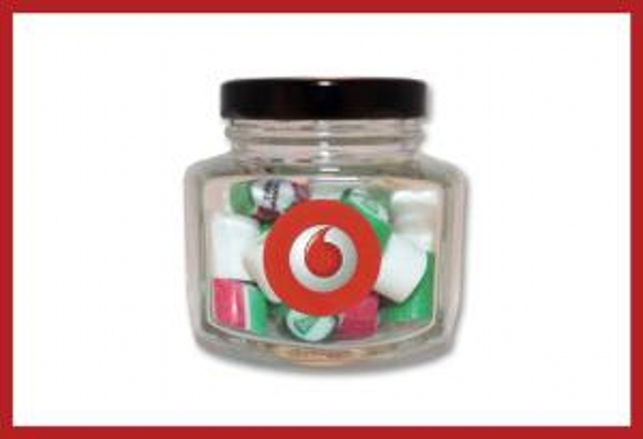 Picture of Christmas rock candy in hexagonal jar with label